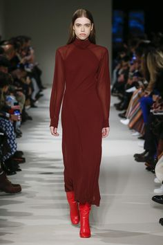 #VBAW17 Victoria Beckham High Neck Asymmetric Twist Midi Dress In Bordeaux worn with Heel Calf Leather Boots in Raspberry Pink.
