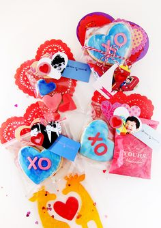 """Our handmade valentine 2016 My 4 year old son helped me decorate the sugar cookies with blue (his favorite color) edible color. I decorated the cookies with heart doilies + red heart stickers + blue tags + """"from my heart"""" stamps all from Inspire Lovely Etsy"""