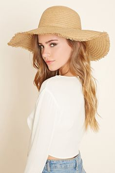 A straw hat featuring a floppy wide brim with frayed ends.
