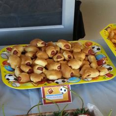 """All the food had sports themed buffet cards with labels. These were labeled as """"Mini Pigskins"""" - Sports theme baby shower."""