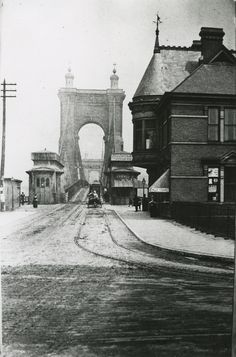 """cincylibrary: """"From our Inland Rivers Photograph Collection: approach to the Suspension Bridge from Covington to Cincinnati, circa 1890. The sign at the bridge entrance reads """"TROTTING POSITIVELY..."""