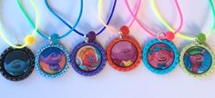 Bottle Cap Necklaces are colored bottle caps with colorful images printed on high quality glossy photo paper. Bottle Cap Necklaces on assorted colored laces necklaces. Images are sealed with premium 3-D epoxy domes for super clear, high gloss pictures. | eBay!