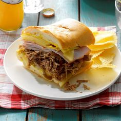 Pressure Cooker Cuban Pulled Pork Sandwiches Recipe -I lived in Florida for a while and loved the pork they would make, so I went about making it for myself! The flavorful meat makes amazing Cuban sandwiches, but you can also use it in traditional pulled pork sandwiches or even tacos. —Lacie Griffin, Austin, Texas