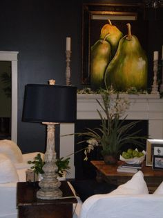 Love the pop of green in the painting and plants with the crispness of the grey walls and white trim and furniture