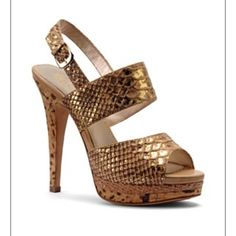Isola Gold Metallic Sandal This sandal has a beautiful gold snake print with a spotted cork heel. It glistens in the sun. So stylish and beautiful on the foot. Runs small. Fits more like an 8. EUC. Box included Isola Shoes