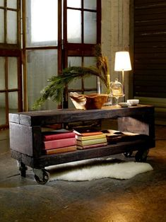 Combine reclaimed wood and casters to create a rugged coffee table  with a touch of industrial chic, a beautiful centerpiece for your  living room