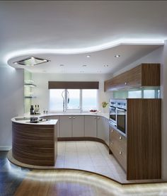 Contemporary Kitchen Design With Curve Wooden Kitchen Cabinet and White Countert. - Home Decor Design Contemporary Kitchen Design With Curve Wooden Kitchen Cabinet and White Countert. Wooden Kitchen Cabinets, Kitchen Cupboard Designs, Kitchen Cupboard Doors, Best Kitchen Designs, White Cabinets, Pantry Cabinets, Luxury Kitchen Design, Contemporary Kitchen Design, Luxury Kitchens