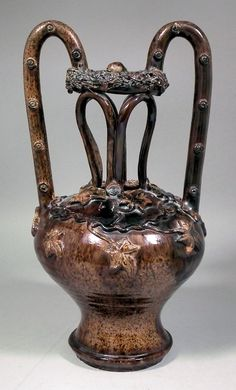 19th Century  treacle  glazed pottery puzzle jug, moulded with ivy leaves and tendrils, 13ins high