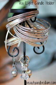 13 DIY Jewelry Organizers That Will Make You Happy...I've started devouring all our candle stick holders w/ my bangles!!! Easy,& pretty,quick fix!!!!