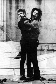 Blixa Bargeld and Nick Cave cutting a rug together