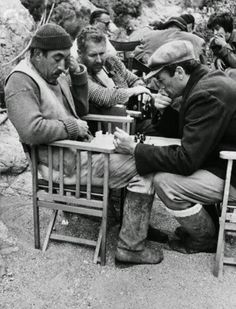 "Gregory Peck and Anthony Quinn playing chess, during the filming of ""Guns of Navarone"" in Rhodes ~ 1960"