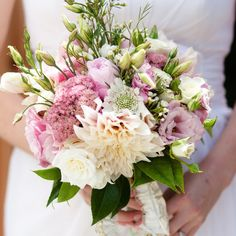 pink lisianthus, dinner plate dahlias, white spray roses and scabiosa.
