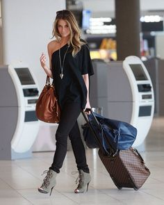 If hours spent on a plane always leave you feeling less confident about your look, this outfit idea can change the situation. You can never go wrong with black pants, matching oversized one shoulder t-shirt and grey open-toe ankle boots. A long necklace with a cute pendant will complete your look
