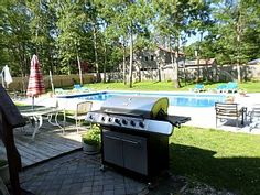 outdoor grill and pool area at shell house Shell House, House Property, Outdoor Furniture Sets, Outdoor Decor, The Hamptons, Sea Shells, Swimming Pools, House Rentals, Bays