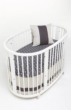 fun oval crib with cute grey sheets http://rstyle.me/n/vvtwzr9te