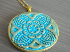 Turquoise and golden polymer clay pendant- oriental inspired design