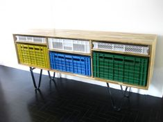 "Great furniture piece for a foyer, a dining room ""buffet"", a bedroom for sock and ""undie"" storage, etc.  Made from reused shipping crates and plastic bin ""drawers"".  Awesome!"