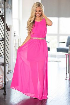 This stunning maxi dress is made for special occasions! We love the vibrant hot pink color paired with the gold, aqua, fuchsia, and mint accents at the waist! It's such a bold choice for spring and su
