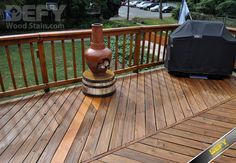 Pressure treated deck after DEFY Extreme Wood Stain in cedar tone was applied