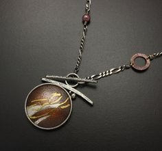 Gold and silver Keum Boo on the textured copper necklace