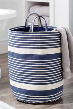 Handle each load of laundry with ease when you fill Pier 1's Striped Laundry Tote with your dirties. Tall, slim and striped with handy handles, it's the perfect pick for making every load of clothes easier to carry, load, wash and fold. Basket Shelves, Storage Baskets, Unique Home Decor, Home Decor Items, Deco Marine, Wash And Fold, Small Laundry Rooms, Trendy Colors, Room Themes