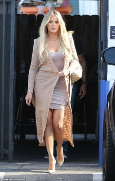 Chic: Khloe Kardashian wore a bodycon dress under a long beige coat as she left a studio in Van Nuys on Wednesday