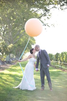over-sized balloon portrait, photo by Lens CAP Photography http://ruffledblog.com/new-england-vineyard-wedding #weddingphotography #weddingportrait