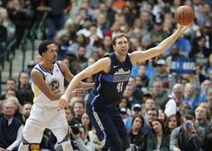 Dallas Mavericks forward Dirk Nowitzki (41) of Germany reaches for the ball against Golden State Warriors guard Shaun Livingston (34) during the first half of an NBA basketball game in Dallas, Wednesday, Jan. 3, 2018. (AP Photo/LM Otero)