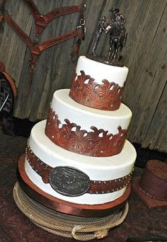 This is BY FAR my favorite wedding cake!!! Tooled leather western cake Dan wants you to have this cake for your birthday!
