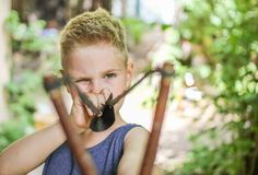 be afraid of :) - my son with a slingshot - be afraid of - my son with a slingshot