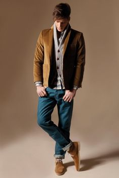 Caramel Colored Corduroy Jacket and Desert Boots, Gray Sweater, and Worn Fitted Jeans. Men's Fall Winter Fashion.