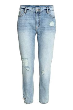 Girlfriend Trashed Jeans: 5-pocket ankle-length jeans in washed denim with hard-worn details in a slightly looser fit with a regular waist and tapered legs