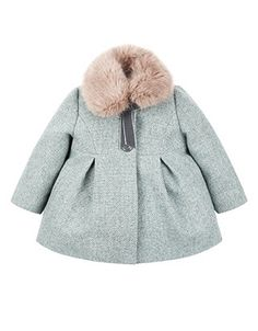 Wonderfully warm and cosy, our aqua tweed Alice swing coat for baby girls is adorned with a velvet ribbon bow, a rounded collar with a detachable faux fur stole, and a back bow detail. Lined in smooth silver satin for a comfortable fit, this charming piece also features two front button fastenings, box pleats and side pockets.