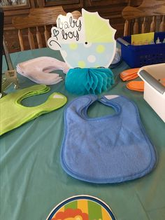 Bib decorating station, bins from Amazon. Paint is easier than markers.