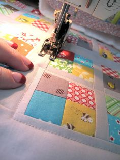 """Good to know (as well as other tips) - I ALWAYS use a walking foot when I am machine quilting. A walking foot allows the top, middle and bottom layer of the quilt to feed through the machine at the same speed...so that means no shifting... gathering or puckers when quilting. I quilt 1/8"""" from the edge to hold it down nice and flat for binding...then I trim the excess batting and backing fabric away."""