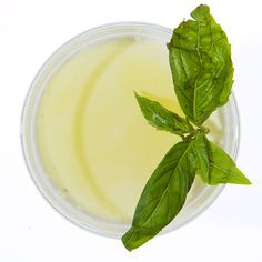 In a shaker, muddle 5 cardamom pods. Add 7 basil leaves, 1 egg white, 3/4 oz. lime juice, 2 oz. DH Krahn gin, and 1/2 oz. each green Chartreuse and simple syrup. Shake with ice, and strain into a chilled rocks glass. Garnish with basil.