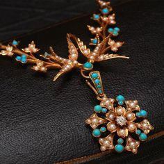 Lovebirds, this c. 1860's necklace is for you. In 15k gold, with turquoise, seed pearls, and a diamond.