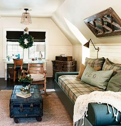 A garage apartment with a plaid couch