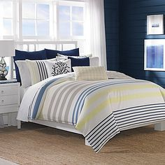 Transform your bedroom into a seaside retreat with the Nautica Leighton Comforter Set. Decorated with a classic palette of navy, harbor blue, and stone with a fresh lemon yellow accent, the nautical bedding is a charming addition to any room's décor.