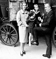 Princess Grace and her family - Caroline, Albert and Rainier - posing for an informal portrait.