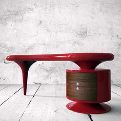 Add a striking contrast to your living room or study by getting a piece of modern design called Bean Desk.