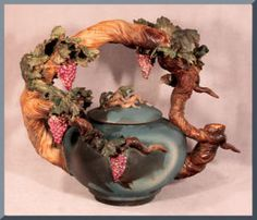 Grapevine Teapot .I will pin this one but it's hardly a teapot, it's an ornament of a teapot not functional but nice. Mata Hari