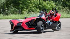 (3-wheel motorcycle - 2 front, 1 back) ... The not-so-secret 2015 Polaris Slingshot has a steering wheel and bucket seats. So we shouldn't even be reviewing it, right? I kinda felt that way when given...