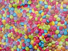Smarties sweets multicoloured candies Oilcloth by TheFabricShopUK