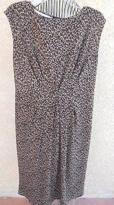 This is a sexy, sleeveless, stretchy dress with a brown and beige animal print, by Talbots, in regular size M or Medium for women. The fabric is a Polyester / Spandex mix. The waist is slightly elasti