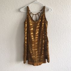 Gold sequin dress STUNNING gold sequin dress from urban outfitters. Worn a couple of times but overall in good condition. Comes with gold slip pictured above. Some sequins missing but not noticeable from afar. Urban Outfitters Dresses Mini