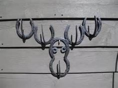 Moose Hat Rack Made Out Of Horse Shoes by JaritJohnson on Etsy1500 x 1125 | 510.6 KB | www.etsy.com