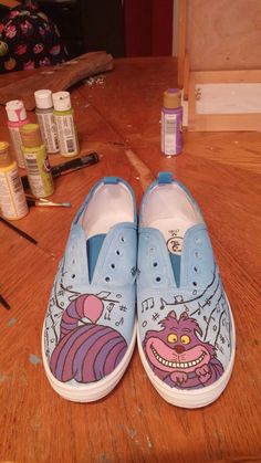 A pair of shoes I did for my sister. Cheshire cat and music notes!