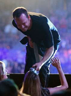 Singer Donnie Wahlberg of New Kids on the Block holds his microphone out to fans as he performs during the kickoff of The Main Event tour at the Mandalay Bay Events Center on May 1, 2015 in Las Vegas, Nevada.