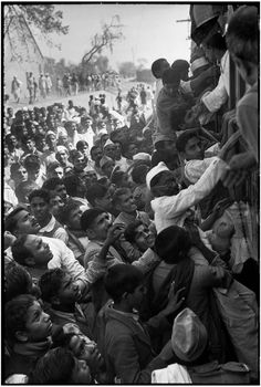 The train carrying Gandhi's ashes to the river Ganges, where they were to be scattered. Crowds lined the railway tracks to see and touch Gandhi's ashes, and pay a last tribute to their leader. Delhi, India 1948 -  Henri Cartier-Bresson, Magnum Photos